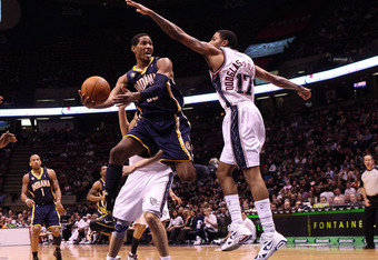EAST RUTHERFORD, NJ - JANUARY 15:  Danny Granger #33 of the Indiana Pacers drives to the hoop against Chris Douglas-Roberts #17 of the New Jersey Nets at the Izod Center on January 15, 2010 in East Rutherford, New Jersey. NOTE TO USER: User expressly ackn