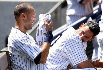 NEW YORK, NY - JULY 09:  Derek Jeter #2 and Jorge Posada #20 of the New York Yankees laugh while sitting in the dugout against the Tampa Bay Rays at Yankee Stadium on July 9, 2011 in the Bronx borough of New York City.  (Photo by Nick Laham/Getty Images)