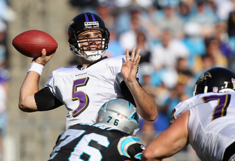 CHARLOTTE, NC - NOVEMBER 21:  Joe Flacco #5 of the Baltimore Ravens drops back to pass against the Carolina Panthers at Bank of America Stadium on November 21, 2010 in Charlotte, North Carolina.  (Photo by Streeter Lecka/Getty Images)