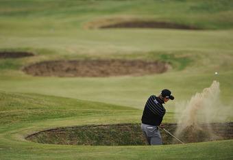 SANDWICH, ENGLAND - JULY 14:  Amateur Tom Lewis of England hits from a bunker on the 13th hole during the first round of The 140th Open Championship at Royal St George's on July 14, 2011 in Sandwich, England.  (Photo by Stuart Franklin/Getty Images)