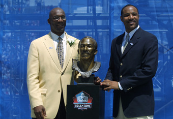 CANTON, OHIO - AUGUST 3:  John Stallworth (left) stands next to his bust with his presenter, son John Stallworth, Jr. after his induction into the National Football League Hall of Fame on August 3, 2002 at Fawcett Stadium in Canton, Ohio.  Stallworth play