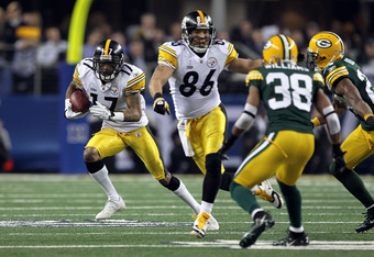 ARLINGTON, TX - FEBRUARY 06:  Mike Wallace #17 of the Pittsburgh Steelers runs with the ball behind the block of Hines Ward #86 against Tramon Williams #38 of the Green Bay Packers during Super Bowl XLV at Cowboys Stadium on February 6, 2011 in Arlington,