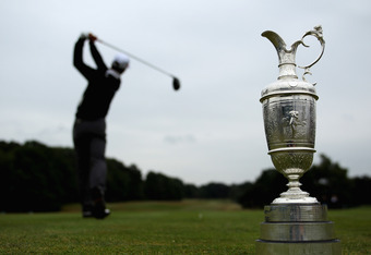 SUNNINGDALE, ENGLAND - JUNE 06:  A player tees off as the Claret Jug is displayed during The Open Championship Europe International Final Qualifying at Sunningdale Golf Club on June 6, 2011 in Sunningdale, England.  (Photo by Warren Little/Getty Images)