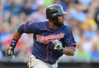 KANSAS CITY, MO - JUNE 3: Denard Span #2 of the Minnesota Twins watches a 2-RBI double against the Kansas City Royals in the second inning at Kauffman Stadium on June 3, 2011 in Kansas City, Missouri. (Photo by G. Newman Lowrance/Getty Images)