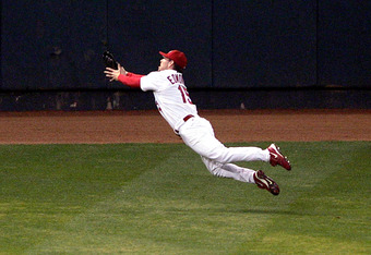 ST LOUIS - OCTOBER 21:  Jim Edmonds #15 of the St. Louis Cardinals makes a diving catch in game seven of the National League Championship Series against the Houston Astros during the 2004 Major League Baseball Playoffs on October 21, 2004 at Busch Stadium