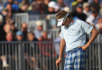 SANDWICH, ENGLAND - JULY 15:  Ian Poulter of England looks dejected on the 18th green during the second round of The 140th Open Championship at Royal St George's on July 15, 2011 in Sandwich, England.  (Photo by Streeter Lecka/Getty Images)