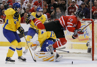 OTTAWA, ON - JANUARY 5:  Cody Hodgson #18 of Team Canada trips over Jacob Markstrom #25 of Team Sweden while rushing the net during the Gold Medal Game of the IIHF World Junior Championships at Scotiabank Place on January 05, 2009 in Ottawa, Ontario, Cana