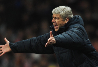 LONDON, ENGLAND - FEBRUARY 16:  Arsene Wenger, Manager of Arsenal shows his frustration during the UEFA Champions League round of 16 first leg match between Arsenal and Barcelona at the Emirates Stadium on February 16, 2011 in London, England.  (Photo by