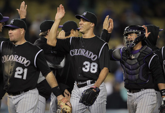 LOS ANGELES, CA - JUNE 01:  (L-R) Ty Wigginton #21, Ubaldo Jimenez #38 and Jose Morales #26 of the Colorado Rockies celebrate following their teams victory over the Los Angeles Dodgers at Dodger Stadium on June 1, 2011 in Los Angeles, California. The Rock