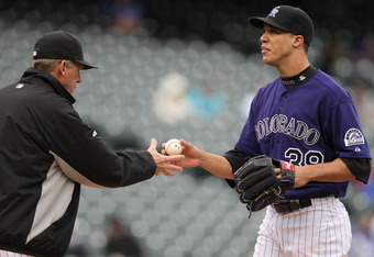 DENVER, CO - MAY 12:  Starting pitcher Ubaldo Jimenez #38 of the Colorado Rockies is removed from the game by manager Jim Tracy #4 of the Rockies in the fourth inning against the New York Mets at Coors Field on May 12, 2011 in Denver, Colorado.  (Photo by