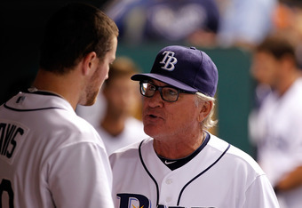 ST. PETERSBURG, FL - JULY 01:  Manager Joe Maddon #70 of the Tampa Bay Rays talks with pitcher Wade Davis #40 during the game against the St. Louis Cardinals at Tropicana Field on July 1, 2011 in St. Petersburg, Florida.  (Photo by J. Meric/Getty Images)