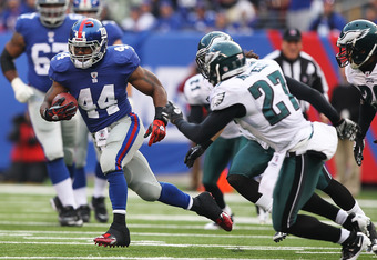 EAST RUTHERFORD, NJ - DECEMBER 19:  Ahmad Bradshaw #44 of the New York Giants runs with the ball as Quintin Mikell #27 of the Philadelphia Eagles defends during their game on December 19, 2010 at The New Meadowlands Stadium in East Rutherford, New Jersey.