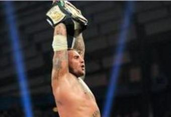 CM Punk celebrating after he won the WWE Championship at the last Money In The Bank PPV