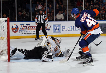 UNIONDALE, NY - MARCH 11: Tim Thomas #30 of the Boston Bruins stops Michael Grabner #40 of the New York Islanders during the second period at the Nassau Coliseum on March 11, 2011 in Uniondale, New York.  (Photo by Bruce Bennett/Getty Images)
