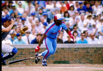 Outfielder Tim Raines of the Montreal Expos drops his bat and prepares to run.