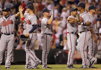 DENVER, CO - JULY 18:  The Atlanta Braves celebrate their 7-4 victory over the Colorado Rockies at Coors Field on July 18, 2011 in Denver, Colorado.  (Photo by Doug Pensinger/Getty Images)