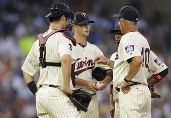 MINNEAPOLIS, MN - JULY 18: Joe Mauer #7, Scott Diamond #58 and pitching coach Rick Anderson #40 of the Minnesota Twins speak on the mound in the fifth inning of game two in a doubleheader against the Cleveland Indians on July 18, 2011 at Target Field in M