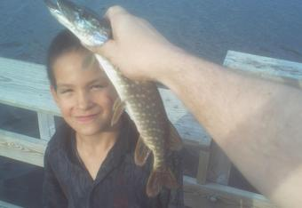 Sage Wagner eyes the northern pike we just caught.