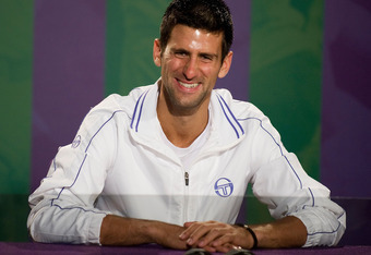 LONDON, ENGLAND - JULY 03:  2011 Wimbledon Champion Novak Djokovic of Serbia speaks at a press conference after winning his final round Gentlemans' match against Rafael Nadal of Spain on Day Thirteen of the Wimbledon Lawn Tennis Championships at the All E