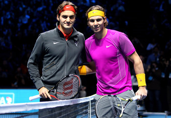 LONDON, ENGLAND - NOVEMBER 28:  Roger Federer of Switzerland (L) and Rafael Nadal of Spain (R) pose on court before their men's final during the ATP World Tour Finals at O2 Arena on November 28, 2010 in London, England.  (Photo by Julian Finney/Getty Imag