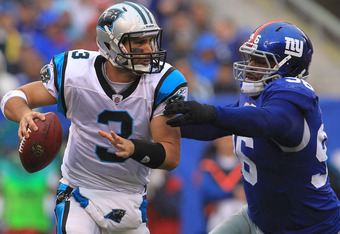 EAST RUTHERFORD, NJ - SEPTEMBER 12:  Matt Moore #3 of the Carolina Panthers is sacked by Barry Cofield #96 of the New York Giants during the NFL season opener at New Meadowlands Stadium on September 12, 2010 in East Rutherford, New Jersey.  (Photo by Chri
