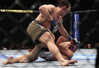 Jake Ellenberger delivering savage ground-and-pound