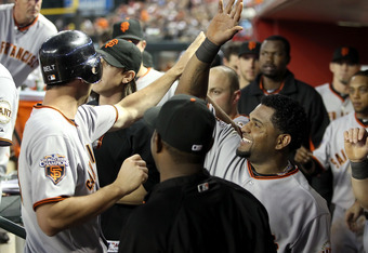 PHOENIX, AZ - APRIL 16:  Pablo Sandoval #48 of the San Francisco Giants high fives teammate Brandon Belt #9 after he scored a seventh inning run against the Arizona Diamondbacks during the Major League Baseball game at Chase Field on April 16, 2011 in Pho