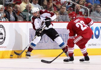 GLENDALE, AZ - APRIL 01:  Ryan O'Byrne #3 of the Colorado Avalanche passes the puck during the NHL game against the Phoenix Coyotes at Jobing.com Arena on April 1, 2011 in Glendale, Arizona.  The Avalanche defeated the Coyotes 4-3 in an overtime shoot out