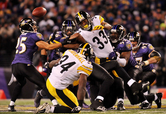 BALTIMORE, MD - DECEMBER 05:  Running back Isaac Redman #33 of the Pittsburgh Steelers fumbles the ball which is recovered by teammate running back Rashard Mendenhall #34 during the second quarter of the game against the Baltimore Ravens at M&T Bank Stadi