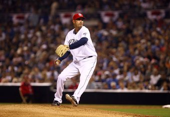 SAN DIEGO - JULY 03:  Mike Adams #37 of the San Diego Padres pitches against Los Angeles Dodgers at Petco Park on July 3, 2009 in San Diego, California.  (Photo by Jeff Gross/Getty Images)