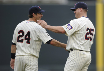 MINNEAPOLIS, MN - JULY 17: Trevor Plouffe #24 and Jim Thome #25 of the Minnesota Twins celebrate a win against the Kansas City Royals on July 17, 2011 at Target Field in Minneapolis, Minnesota. The Twins defeated the Royals 4-3. (Photo by Hannah Foslien/G
