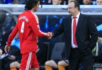 HULL, ENGLAND - MAY 9:  Alberto Aquilani of Liverpool shakes hands with manager Rafael Benitez as he is substituted during the Barclays Premier League match between Hull City and Liverpool at the KC Stadium on May 9, 2010 in Hull, England. (Photo by Jed L