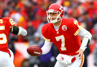 KANSAS CITY, MO - JANUARY 09:  Quarterback Matt Cassel #7 of the Kansas City Chiefs fakes a hand-offagainst the Baltimore Ravens in their 2011 AFC wild card playoff game at Arrowhead Stadium on January 9, 2011 in Kansas City, Missouri.  (Photo by Dilip Vi