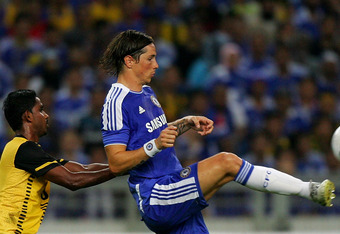 KUALA LUMPUR, MALAYSIA - JULY 21: Fernando Torres (R) of Chelsea is checked by Gary Stevan of Malaysia  during the pre-season friendly match between Malaysia and Chelsea at Bukit Jalil National Stadium on July 21, 2011 in Kuala Lumpur, Malaysia.  (Photo b