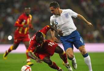 LONDON, ENGLAND - MARCH 29:  Phil Jagielka of England (R) tackles Kwadwo Asamoah of Ghana during the international friendly match between England and Ghana at Wembley Stadium on March 29, 2011 in London, England.  (Photo by Clive Rose/Getty Images)