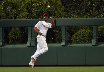 PHILADELPHIA, PA - JULY 08: John Mayberry Jr. #15 of the Philadelphia Phillies runs down a fly ball hit by Freddie Freeman of the Atlanta Braves at Citizens Bank Park on July 8, 2011 in Philadelphia, Pennsylvania. The Phillies won 3-2 in the bottom of the