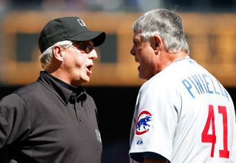 SEATTLE - JUNE 24:  Manager Lou Piniella #41 of the Chicago Cubs argues a call with third base umpire Mike Reilly #31 after Chone Figgins of the Seattle Mariners was called safe on a steal at Safeco Field on June 24, 2010 in Seattle, Washington. (Photo by