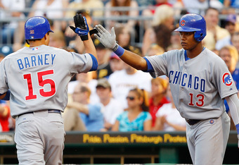 PITTSBURGH - JULY 09:  Darwin Barney #15 of the Chicago Cubs is congratulated by teammate Starlin Castro #13 after scoring against the Pittsburgh Pirates during the game on July 9, 2011 at PNC Park in Pittsburgh, Pennsylvania.  (Photo by Jared Wickerham/G