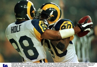 F363722 59: (North And South America Sales Only) Torry Holt (#88) Of The St Louis Rams Celebrates With Isaac Bruce (#80) After Scoring A Touchdown In The Third Quarter Of Super Bowl Xxxiv Between The St Louis Rams And Tennessee Titans On January 30, 2000.
