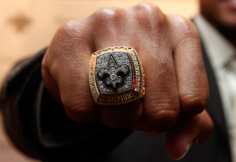 NEW ORLEANS - JUNE 16:  A member of the New Orleans Saints shows off his ring from Super Bowl XLIV on June 16, 2010 in New Orleans, Louisiana.  (Photo by Chris Graythen/Getty Images)