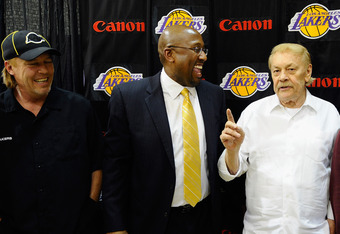 Jim Buss and owner Jerry Buss at Mike Brown's introductory press conference.  The coaching decision was not communicated effectively according to individuals within the organization