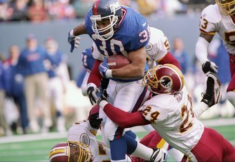 13 Dec 1997:  Running back Charles Way #30 of the New York Giants carries the football as defensive back Stanley Richard #24 holds on during the Giants 30-10 win at Giants Stadium in East Rutherford, New Jersey. Mandatory Credit: Ezra O. Shaw  /Allsport