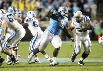 CHAPEL HILL, NC - NOVEMBER 7:  Marvin Austin #9 of the North Carolina Tar Heels rushes against Brian Moore #68 of the Duke Blue Devils at Kenan Stadium on November 7, 2009 in Chapel Hill, North Carolina. (Photo by Streeter Lecka/Getty Images)