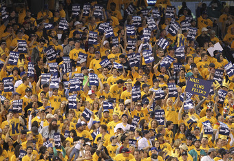 SEATTLE - JUNE 24:  Fans in the 'King Felix' section cheer after starting pitcher Felix Hernandez #34 of the Seattle Mariners singled against the Florida Marlins at Safeco Field on June 24, 2011 in Seattle, Washington. The Mariners defeated the Marlins 5-