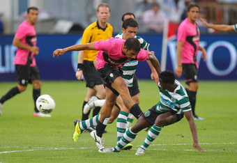 TORONTO, CANADA - JULY 23: Michele Pazienza #14 of Juventus FC battles for the ball with Yannick Djalo #20 of Sporting Clube De Portugal during their World Football Challenge friendly match on July 23, 2011 at BMO Field in Toronto, Ontario, Canada. (Photo