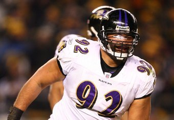 PITTSBURGH - JANUARY 18:  Haloti Ngata #92 of the Baltimore Ravens reacts after he recorded a sack against Ben Roethlisberger #7 of the Pittsburgh Steelers during the AFC Championship game on January 18, 2009 at Heinz Field in Pittsburgh, Pennsylvania. St