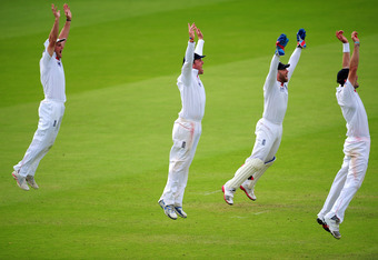 LONDON, ENGLAND - JULY 25:  The England slip corden of Andrew Strauss (l) Graeme Swann,  Matt Prior and James Anderson (r) celebrate the final wicket of the India innings of Ishant Sharma to win the match during day five of the 1st npower test match betwe
