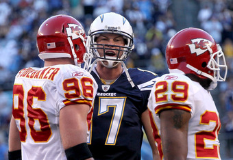 SAN DIEGO - DECEMBER 12:  Quarterbaqck Philip Rivers #17 of the San Diego Chargers talks to linebacker Andy Studebaker #96 and safety Eric Berry #29 of the Kansas City Chiefs after a Charger touchdown put them up 31-0 at Qualcomm Stadium on December 12, 2