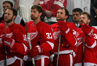 DETROIT - MAY 24:  Kirk Maltby #18, Mikael Samuelsson #37, Darren McCarty #25, Kris Draper #33 of the Detroit Red Wings stand for the National Anthem before game one of the 2008 NHL Stanley Cup Finals against the Pittsburgh Penguins at Joe Louis Arena on