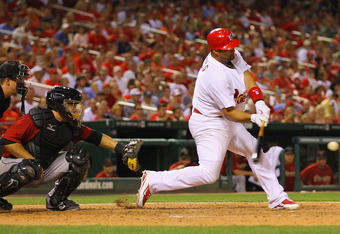 July 26, 2011: Pujols loads up on the ball in St. Louis' Busch Stadium.  He loaded up on Rasmus last season.